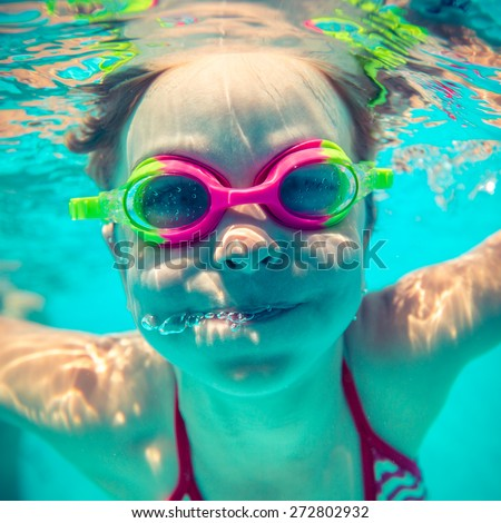 Underwater portrait of happy child. Summer vacation - stock photo