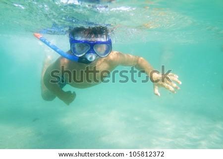 underwater portrait of young boy snorkeling - stock photo