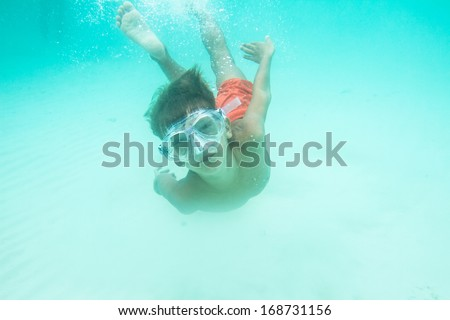 underwater portrait of young boy, snorkeling in mask - stock photo