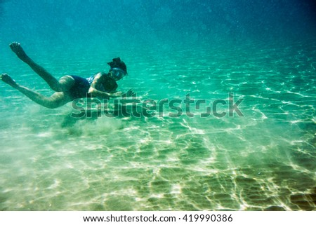 Underwater scene in Ionian sea, Zakynthos, Greece, with girls playing in the water