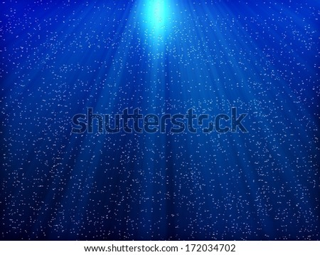 underwater scene sunrays and air bubbles in deep blue sea  - stock photo