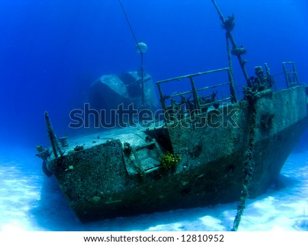 Underwater Shipwreck Tibbits in Cayman Brac with Guns - stock photo