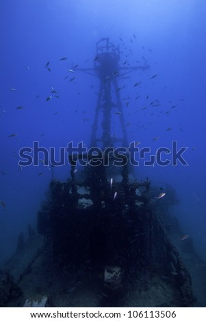 Underwater shipwrecks crows nest with a blue water background in Key Largo, Florida. The Coast Guard Cutter Duane in John Pennekamp State Park. - stock photo