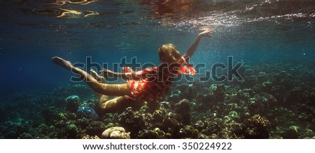 Underwater shoot of a relaxed  flying  woman - stock photo