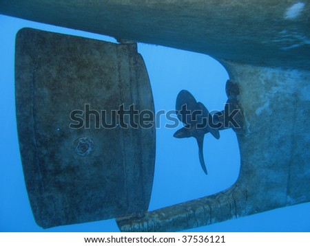 Underwater shot of a Boat propeller. - stock photo