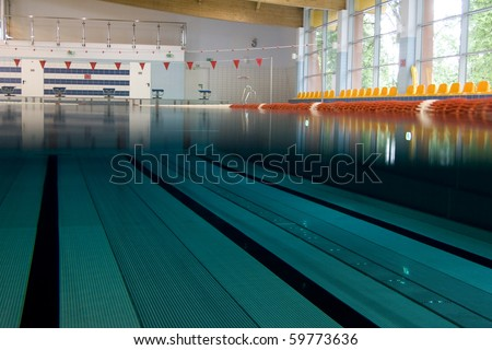 Underwater view on swimming pool - stock photo