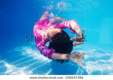 Underwater woman portrait in swimming pool. - stock photo