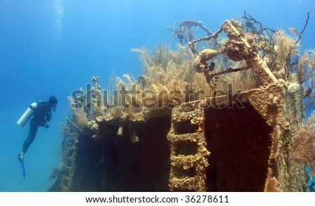 underwater wreck of the price albert covered with coral - stock photo