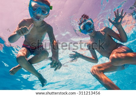 Kids Swimming Underwater kids swimming stock images, royalty-free images & vectors