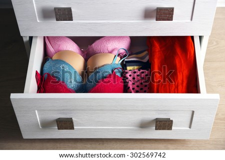 Underwear in wooden chest of drawer, close up - stock photo