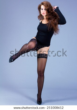 Undressing Posing Woman  - stock photo