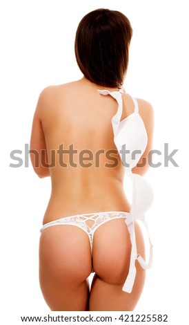 Undressing woman, isolated on white background