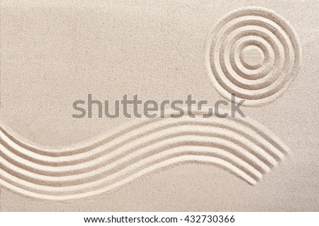 Undulating flowing wave pattern and concentric circles raked in the sand in a traditional Japanese zen garden for wellness and tranquility with copy space - stock photo