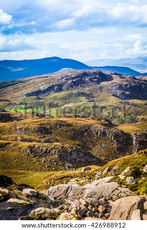 Undulating green, purple and yellow rocky landscape in Kerry in Ireland