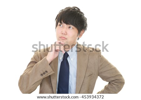 Uneasy Asian Businessman
