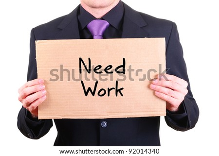 "unemployed businessman with cardboard sign ""Need Work"" - stock photo"