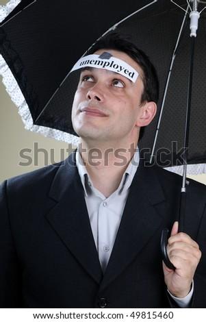 unemployed man thinking of future - stock photo