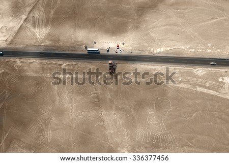 Unesco heritage: Nazca lines in Peru - hand and tree at the observation tower  - stock photo