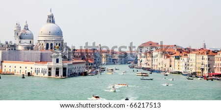 UNESCO World heritage city Venice, Italy at the entrance to canal Grande with old houses, church Santa Maria del Salute,channels and ferries - stock photo