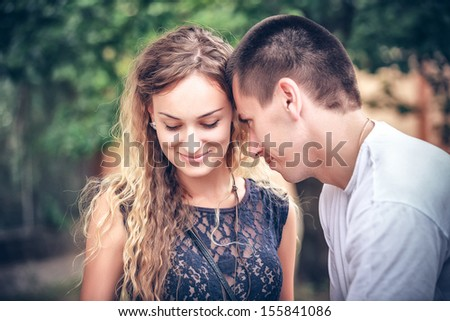 unexpected acquaintance of young people on the street - stock photo