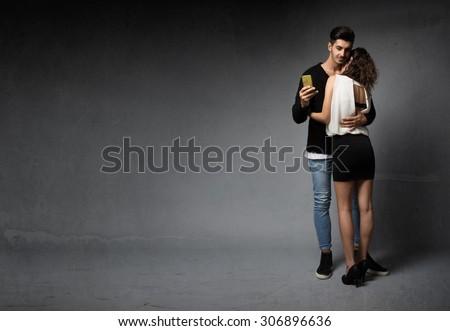 unfaithful man sending message, textured background - stock photo