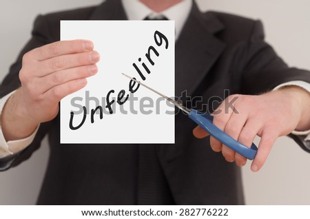 Unfeeling, man in suit cutting text on paper with scissors
