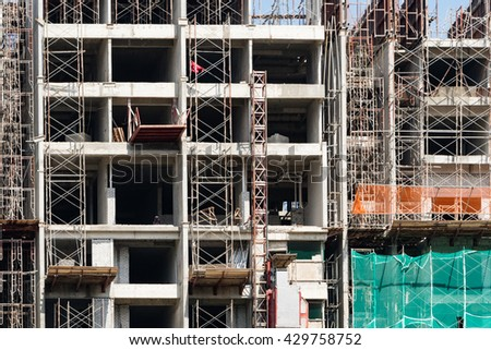 Unfinished Building at Construction Site - stock photo