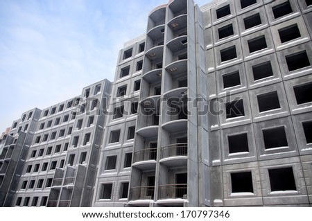 Unfinished building of reinforced concrete panels without windows - stock photo