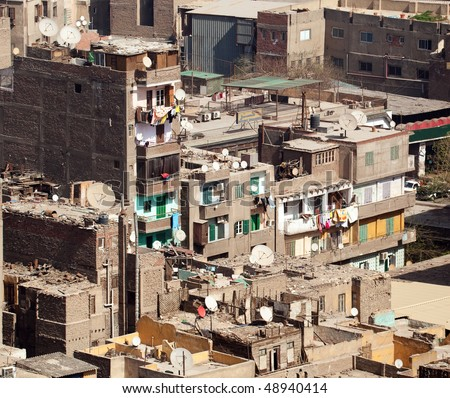 Unfinished buildings in downtown Cairo with trash on all roofs - stock photo