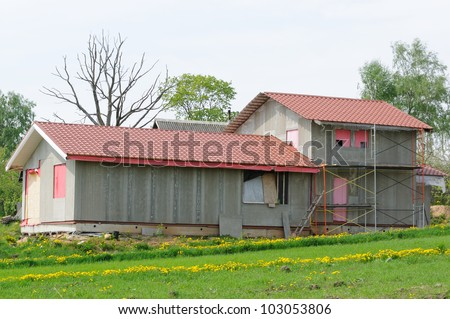 Unfinished Country House with Tiled Roof - stock photo