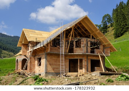 Unfinished, ecological wooden house and building area. Traditional house in Vatra Dornei mountain area, in Romania 2014  - stock photo