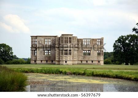 Unfinished Elizabethan Lodge - Sepia - stock photo