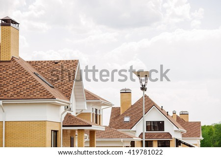 Unfinished european house of brick, still under construction. Building concept - stock photo
