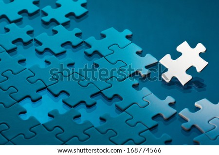 Unfinished jigsaw puzzle. Concept image of difficult problem.