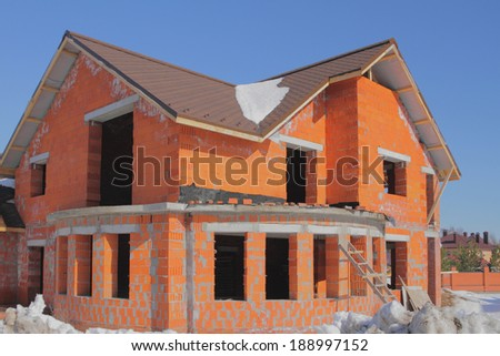 Unfinished two-storeyed cottage from brick