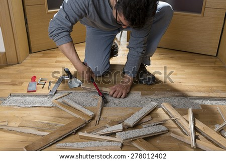 Unfixing Wooden Floor - stock photo