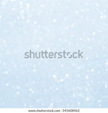 Unfocused abstract light blue glitter bokeh holiday background. Winter xmas holidays. Christmas. - stock photo