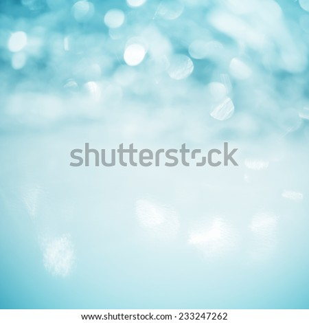 Unfocused abstract turquoise glitter holiday background - stock photo