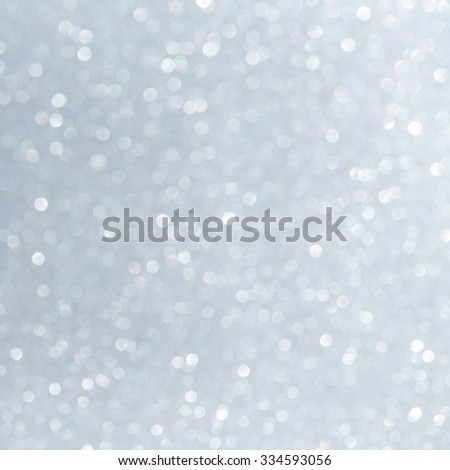 Unfocused abstract white glitter holiday background. Winter xmas holidays. Christmas.