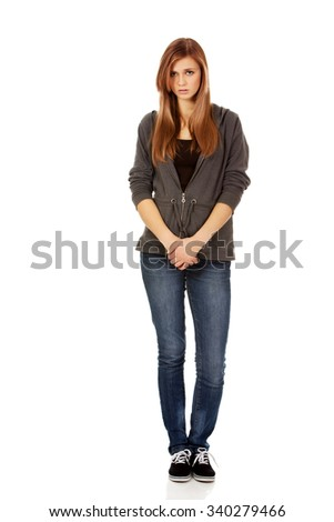 Unhappy and thoughtful teenage woman. - stock photo