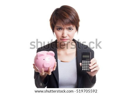 Unhappy Asian business woman with calculator and piggy bank  isolated on white background.