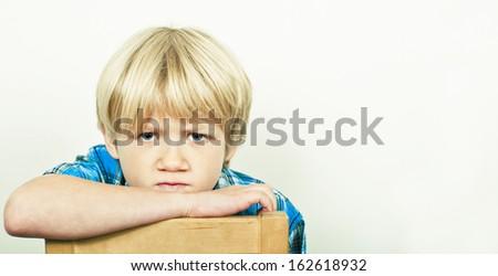 Unhappy boy stock photo