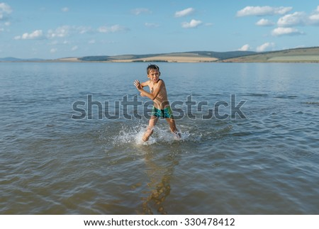 unhappy boy runs out of very cold water