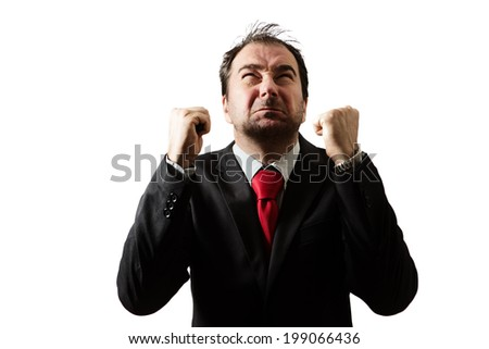 unhappy businessman shaking his hands