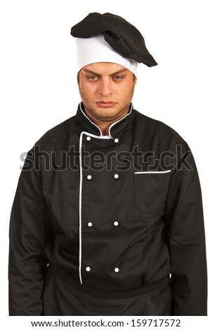Unhappy chef looking down isolated on white background - stock photo
