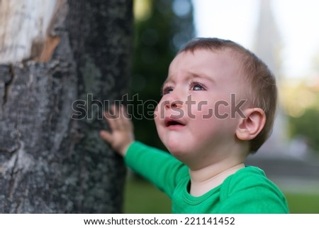 Unhappy child on the nature background  - stock photo
