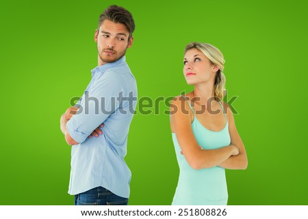 Unhappy couple not speaking to each other against green vignette - stock photo