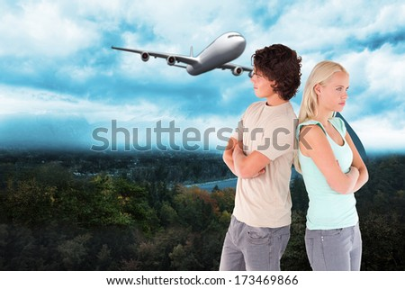 Unhappy couple posing against road turning into arrow - stock photo