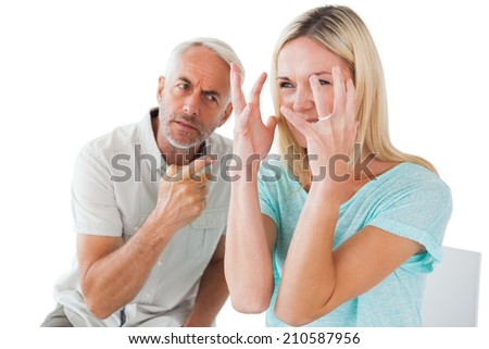 Unhappy couple sitting on chairs having an argument on white background