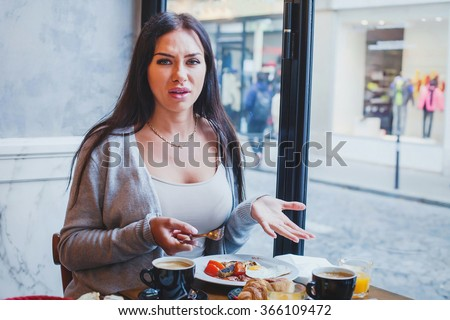 unhappy customer in restaurant, angry woman complaining about food and service in cafe - stock photo